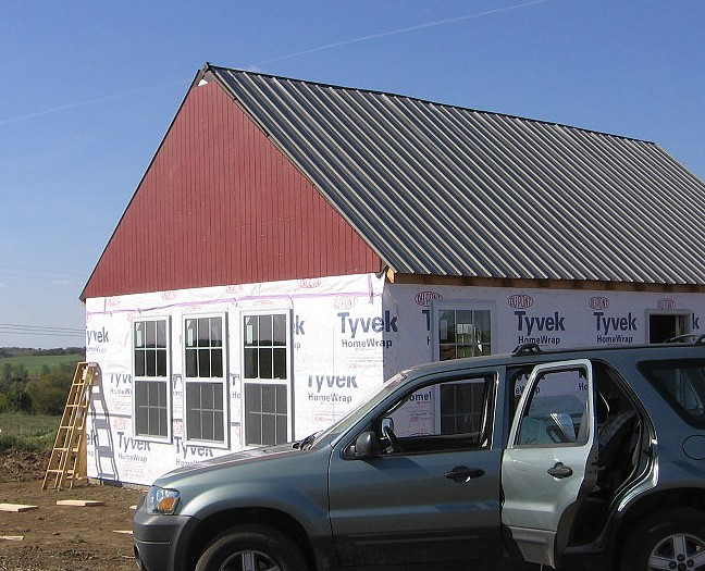 Cheap panel siding on gable end